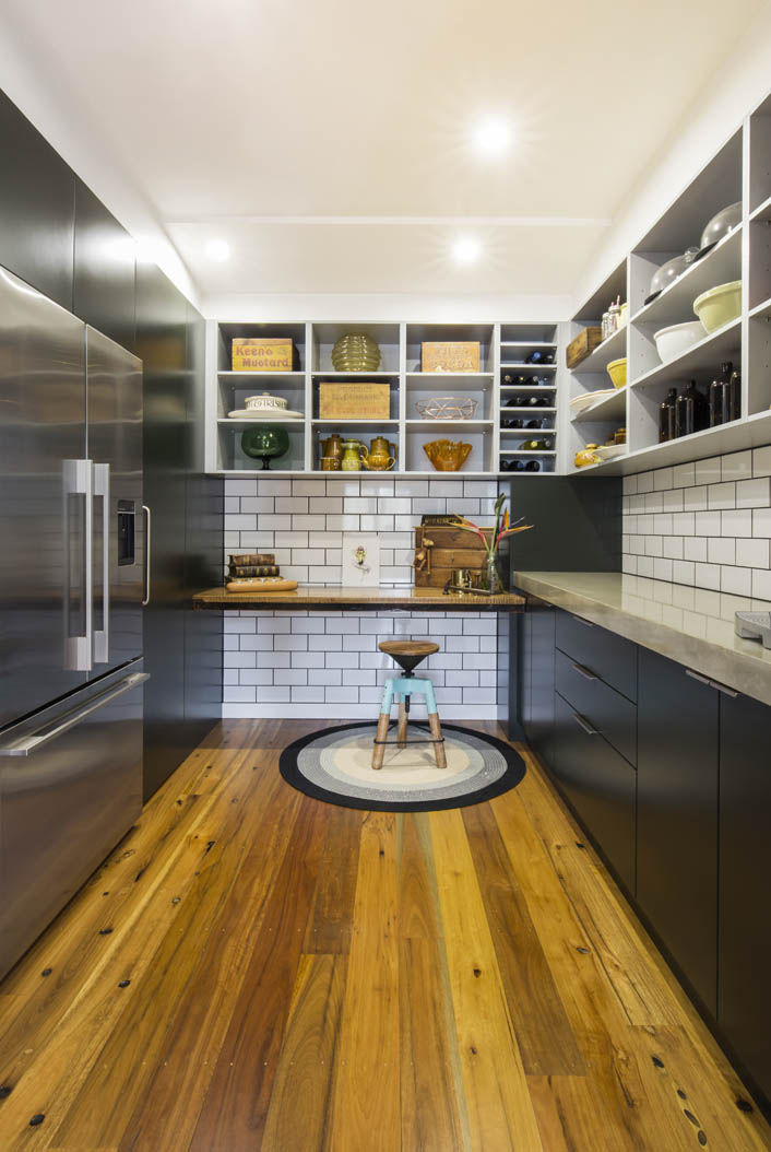 Inside the pantry. White subway tiles and black grout