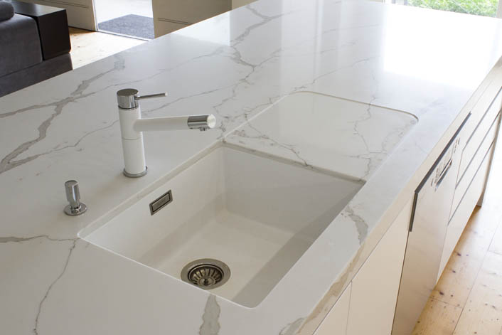 Marble looking benchtop with milled sink drainer