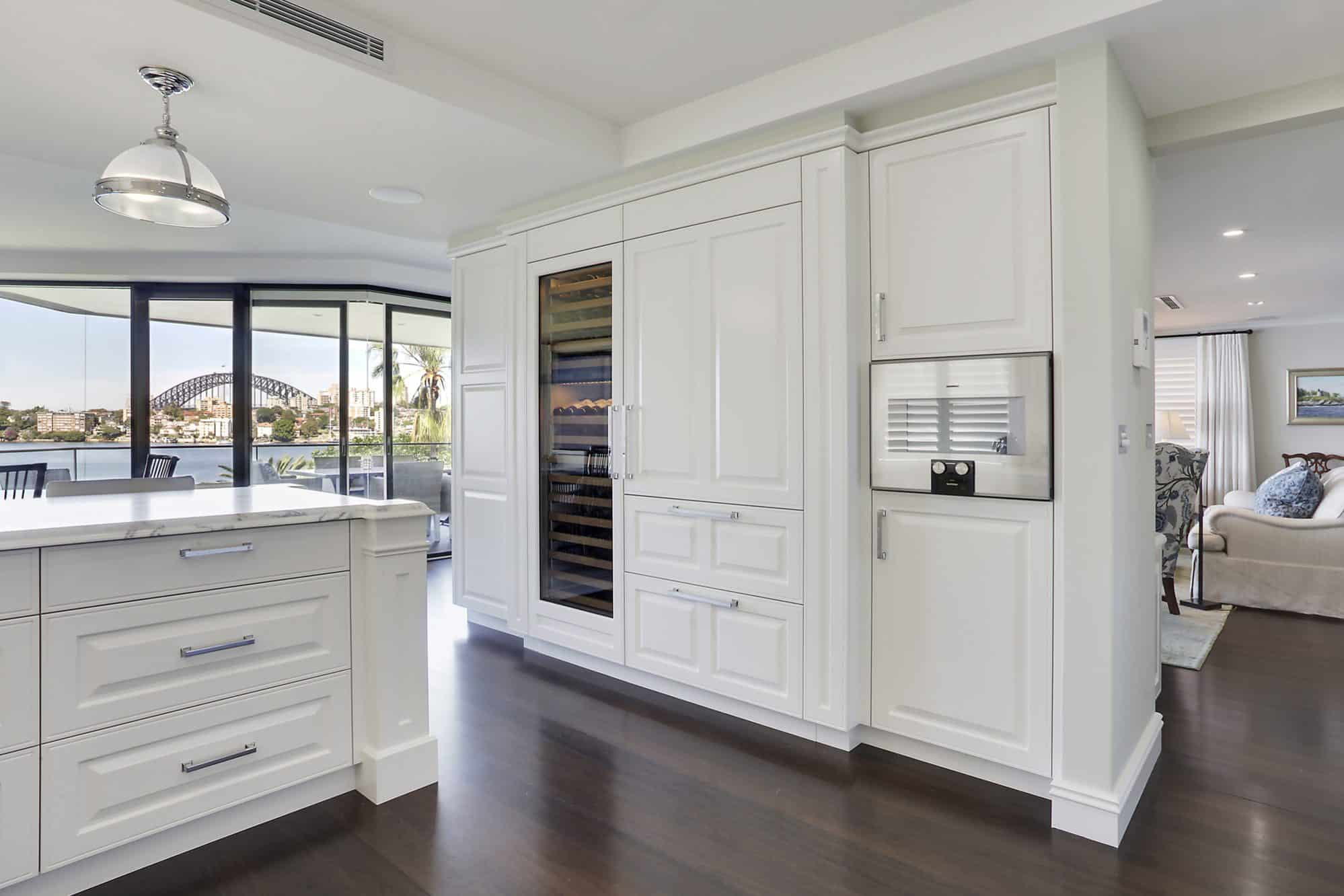 Kitchen cabinetry housing wine storage, integrated fridge and steamer