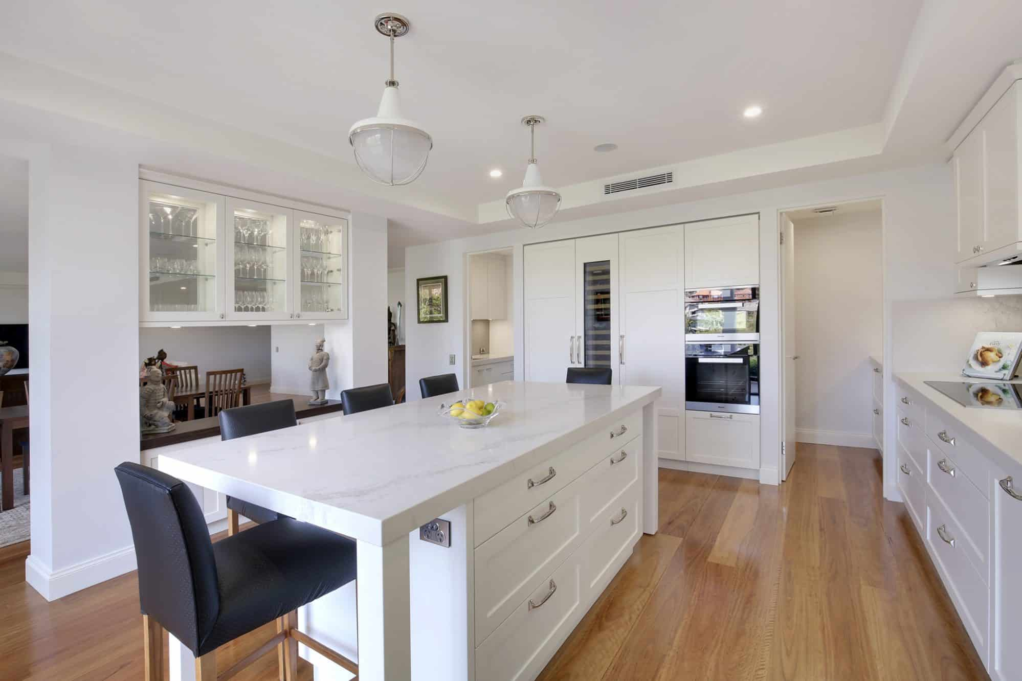 This shaker kitchen includes scullery, laundry and display niche