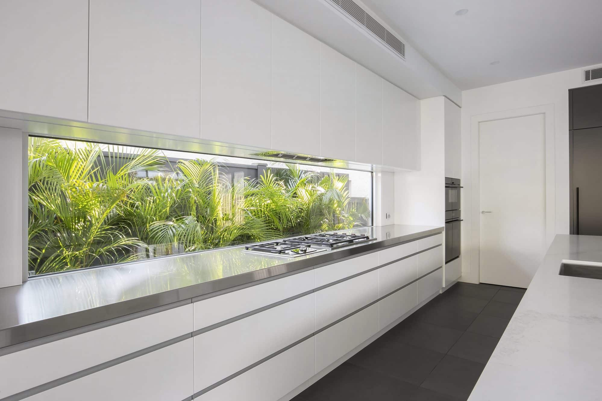 Long window splashback behind a gas cooktop