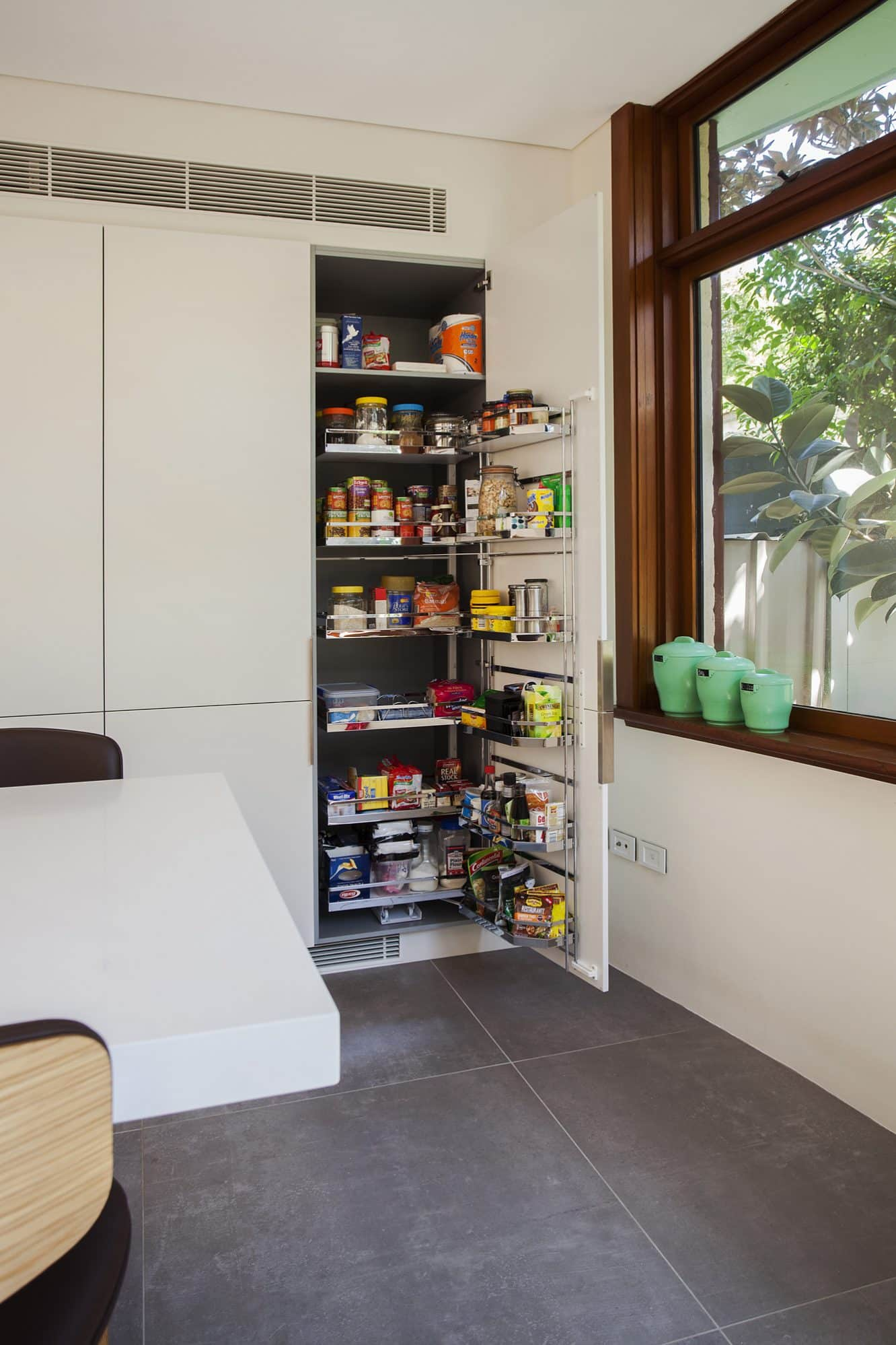 Pull out pantry with chrome shelves