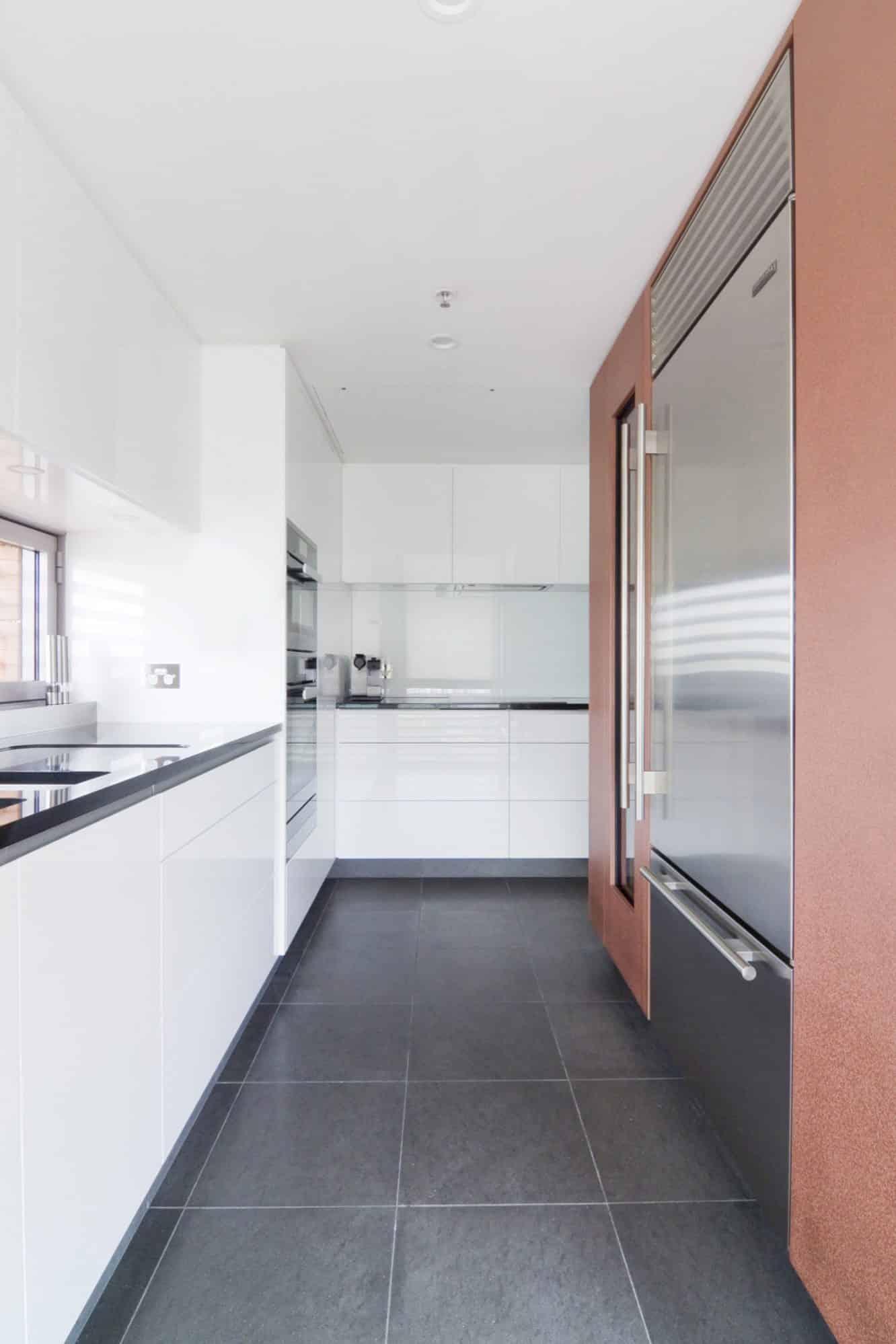 White minimalist kitchen in a luxury Sydney apartment