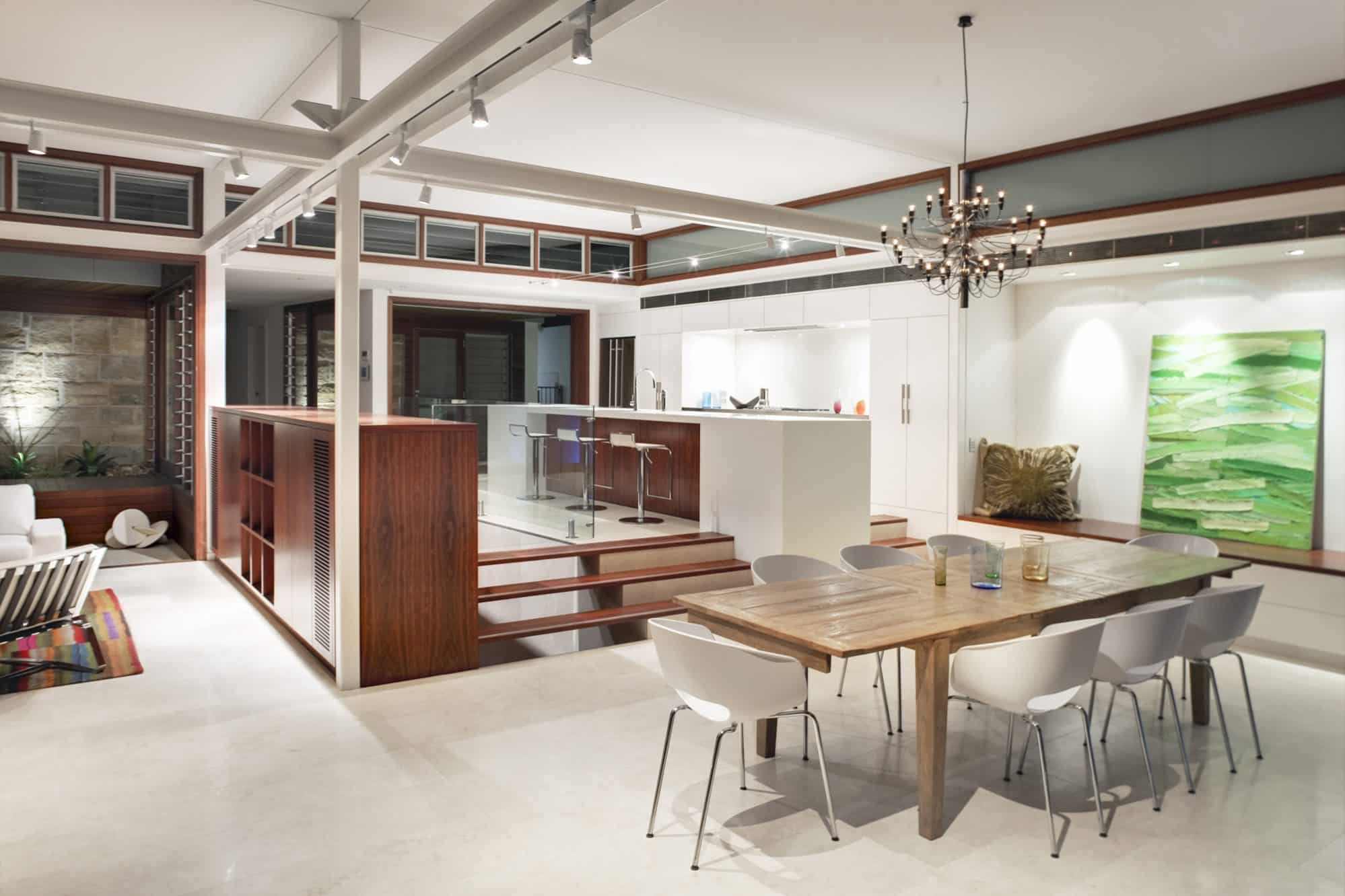 The kitchen sits within the corner of a large open plan room